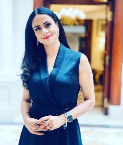 Gul Panag in a black dress.